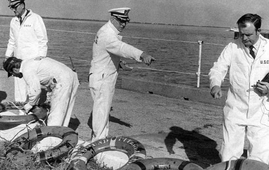 FILE 1975: Coast Guard officers on a Board of Inquiry inspected life rings that were recovered from the ore carrier Edmund Fitzgerald, which sank in stormy weather in Lake Superior on Nov. 10, 1975.