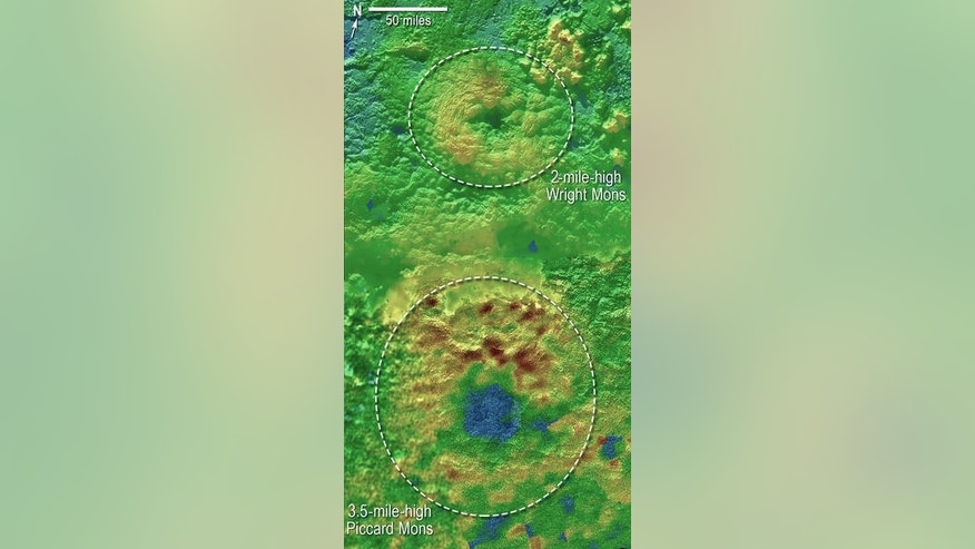 Two of Pluto's mountains, informally named Wright Mons and Piccard Mons, could be ice volcanoes. Blue indicates lower terrain, brown shows higher elevation and green terrains are at intermediate heights. (Credits: NASA/JHUAPL/SwRI)