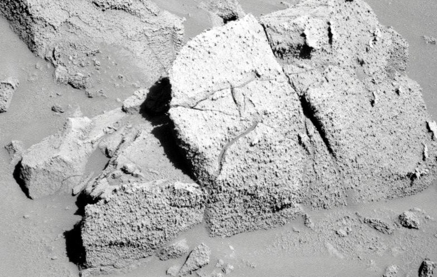 A closer look at rock that is located on the rim of the crater Concepción on Mars. The image was taken by the Mars rover Opportunity back in 2010.