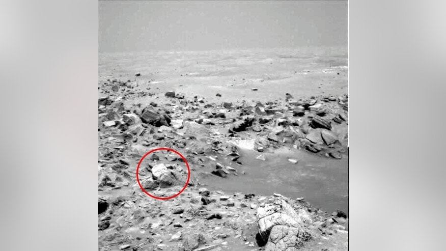 This image from Mars Opportunity appears to show the face of what UFO enthusiasts say is an ancient God. NASA