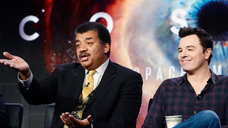 "Host Neil DeGrasse Tyson (L) and Seth MacFarlane, executive producer of ""Cosmos"", participate in Fox Broadcasting Company's part of the Television Critics Association (TCA) Winter 2014 presentations in Pasadena, California, January 13 , 2014. REUTERS/Kevork Djansezian  (UNITED STATES - Tags: ENTERTAINMENT) - RTX17D1T"