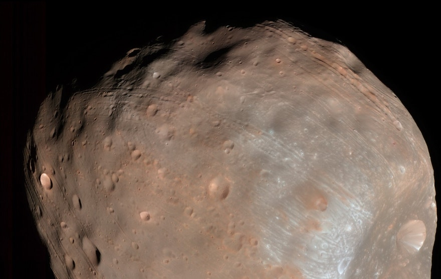 Phobos, the larger of Mars' moons, imaged from a distance of 6,800 kilometers. The Stickney impact crater dominates one hemisphere of the moon (HiRISE image PSP_007769_9010, taken March 23, 2008.)