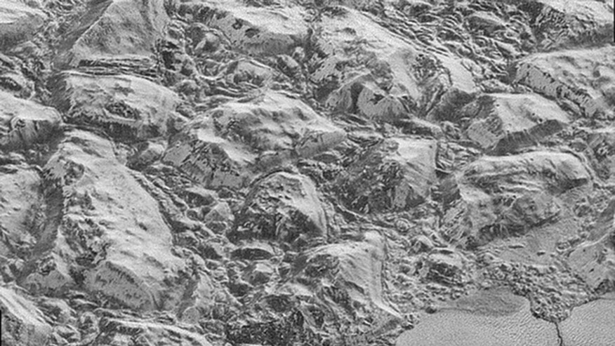 This image from NASA's New Horizons spacecraft shows sections of Pluto's water-ice crust (NASA)