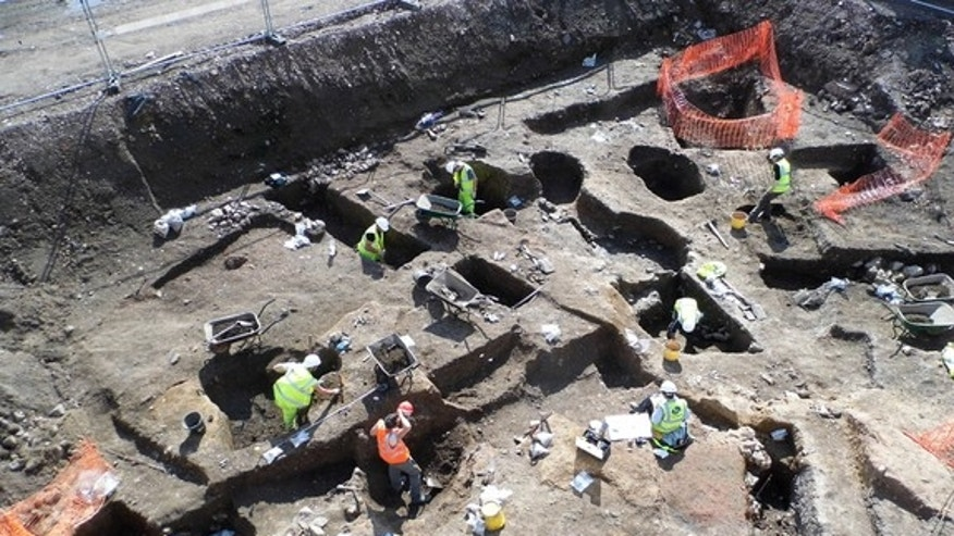 Archaeologists excavate large areas of medieval and post-medieval pitting in the backyards of properties running along Southgates.