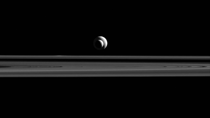 Cassini probe takes 'cosmic bulls-eye' of Saturn moons Enceladus,Tethys