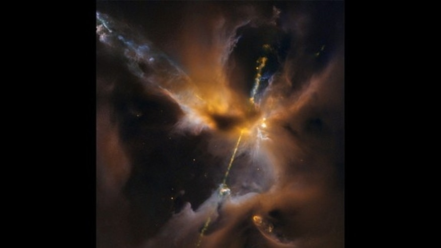 A young star wields a double-bladed lightsaber of its own creation in this infrared image captured by NASA's Hubble Space Telescope.