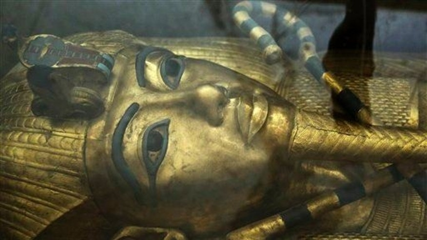 The tomb of King Tut is displayed in a glass case at the Valley of the Kings in Luxor, Egypt, Tuesday, Sept. 29, 2015.