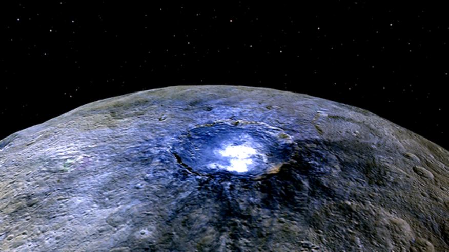 NASA's Dawn spacecraft captured this amazing of Ceres in the asteroid belt, showing the dwarf planet's Occator Crater in false-color. Dawn arrived in orbit around Ceres in March 2015.