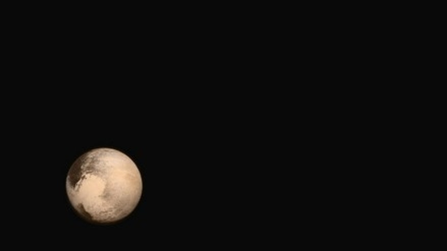 Pluto and its largest moon Charon as seen in natural color by NASA's New Horizons spacecraft during its historic July 2015 flyby of the dwarf planet.