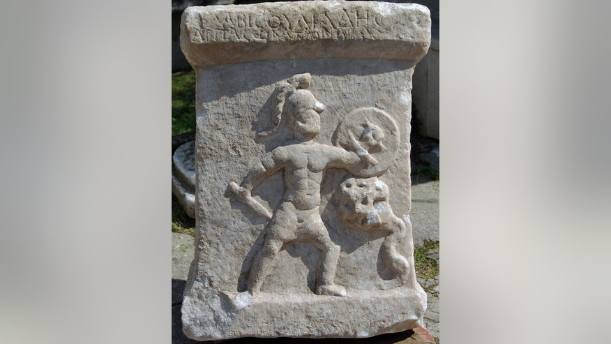 This marble altar, dating to the second century A.D., was discovered near the Akçay River in Turkey. It shows a nude warrior battling a serpent monster. An inscription written in Greek is at top.