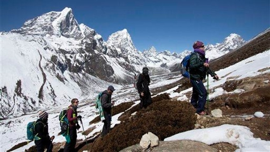 In this March 18, 2015, file photo, trekkers take an acclimatization hike on the way to Everest base camp in Nepal.