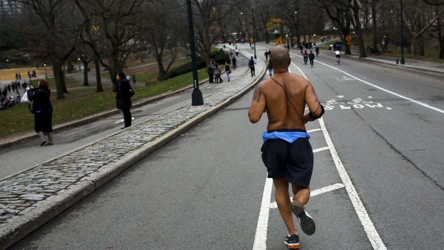 A man jogs during a warm day in Central Park, New York Dec. 25, 2015. (REUTERS/Eduardo Munoz)