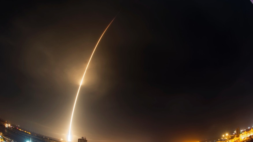 File photo - The SpaceX Falcon 9 rocket lifts off carrying 11 satellites at Cape Canaveral in December. A similar satellite launch could be responsible for the metal balls that landed in Vietnam last weekend.