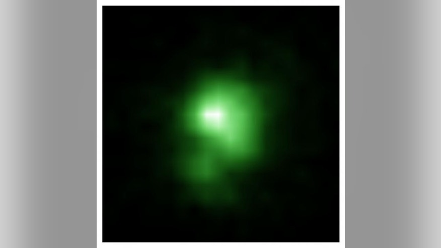 This is a Hubble Space Telescope image of the compact green pea galaxy J0925+1403. The diameter of the galaxy is approximately 6,000 light years, and it is about twenty times smaller than the Milky Way. (NASA)