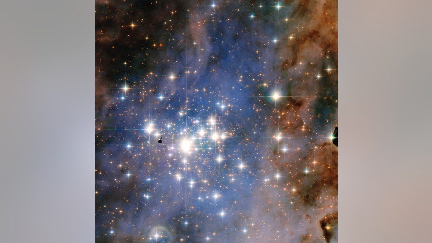 This NASA/ESA Hubble Space Telescope image features the star cluster Trumpler 14. One of the largest gatherings of hot, massive and bright stars in the Milky Way, this cluster houses some of the most luminous stars in our entire galaxy.  Credit: NASA & ESA, Jesús Maíz Apellániz (Instituto de Astrofisica de Andalucia)