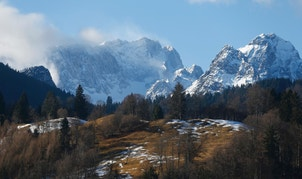Germany's highest mountain, the 2,962 metre (9,718 feet) Zugspitze (L) is pictured from the Bavarian ski resort of Garmisch-Partenkirchen, Germany, January 29, 2016. The training session for the World Cup Men's Downhill was cancelled on Friday. REUTERS/Dominic Ebenbichler  - RTX24J9L