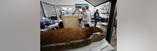 In this Thursday, Jan. 28, 2016, photo, collections technician a secure a crate of artifacts at the Penn Museum in Philadelphia. The archaeology museum has moved thousands of ancient treasures offsite and is using vibration sensors to monitor delicate items still on display while an earth-shaking demolition project continues next door. (AP Photo/Matt Slocum)