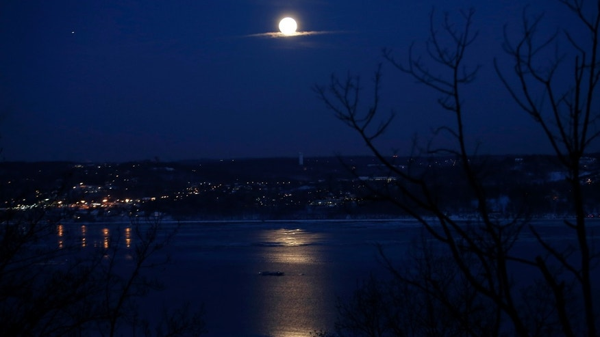 "The full ""Snow"" moon rises above the Hudson River and the town of Irvington in Westchester County New York as seen from the west side of the Hudson in the town of Orangeburg in Rockland County, New York February 3, 2015. ""Snow"" moon is a traditional name for the full moon that occurs in the winter month of February in North America. (REUTERS/Mike Segar)"