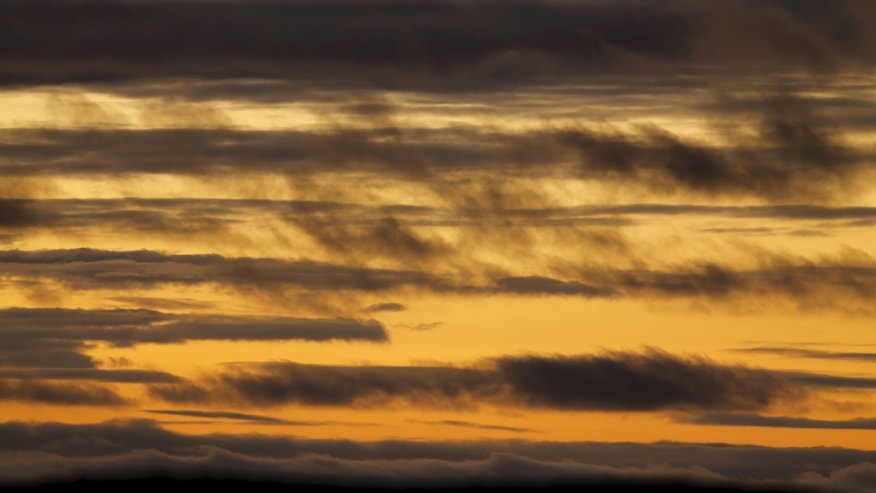 File photo - Clouds float across the Pacific Ocean after sunset in Encinitas, California Jan. 19, 2016. (REUTERS/Mike Blake)