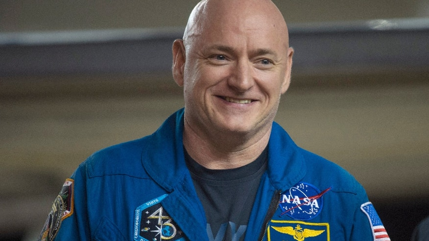 Expedition 46 Commander Scott Kelly of NASA smiles upon arriving at Ellington Field, Thursday, March 3, 2016 in Houston, Texas, after his return to Earth. (Joel Kowsky/NASA via AP)