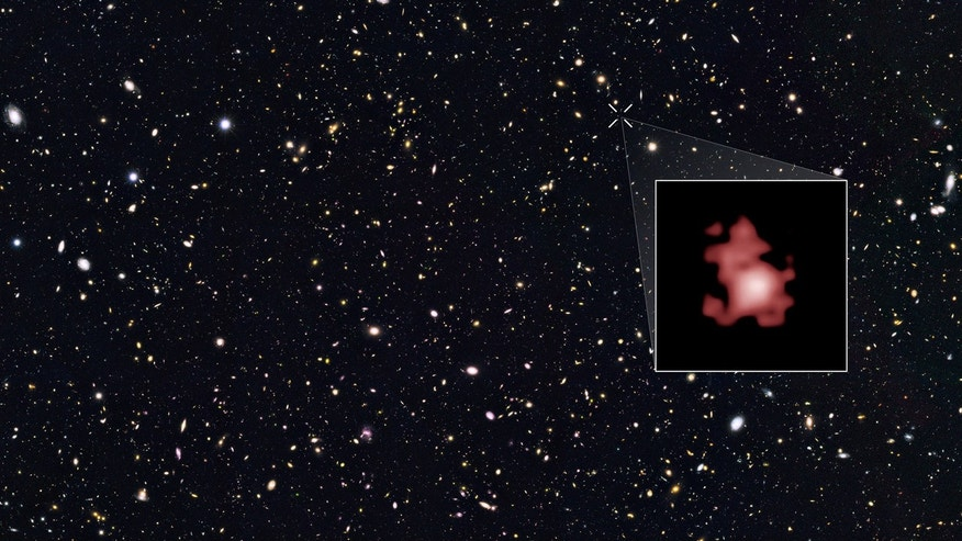 This image provided by the Space Telescope Science Institute, taken with the Hubble Space Telescope, shows a hot, star-popping galaxy that is far, far away, farther than any previously detected, from a time when the universe was a mere toddler of about 400 million years old. (Space Telescope Science Institute via AP)