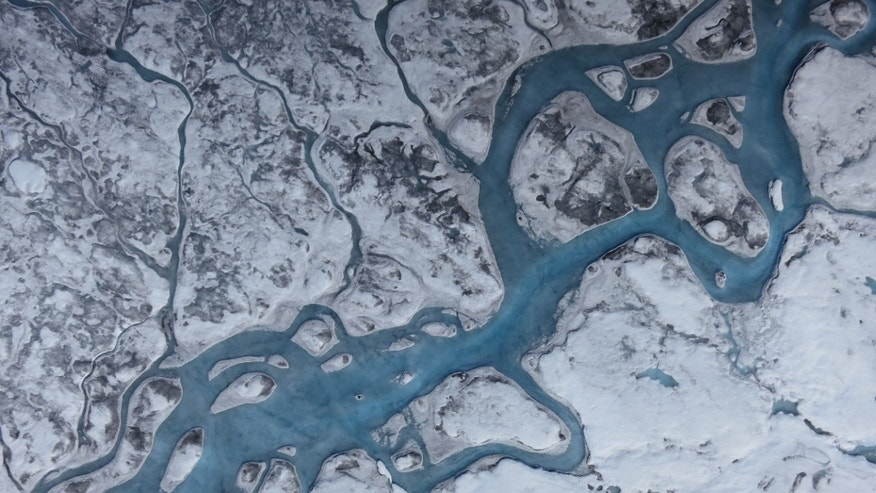 Aerial images of Greenland show rivers of meltwater and areas of dark ice. Greenland's surface is absorbing more solar radiation as melting increases grain size and brings old impurities to the surface. (Marco Tedesco/Lamont-Doherty Earth Observatory)