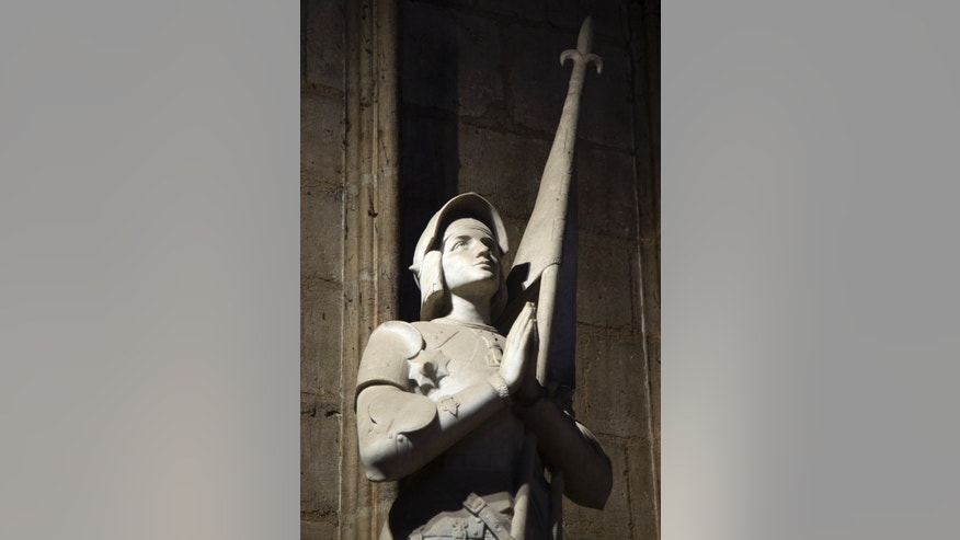 File photo - The statue of Jeanne d'Arc (St Joan of Arc,1412-1431) by French sculptor Charles Desvergnes is pictured inside Notre-Dame de Paris Cathedral in Paris Oct.18, 2012. (REUTERS/Charles Platiau)