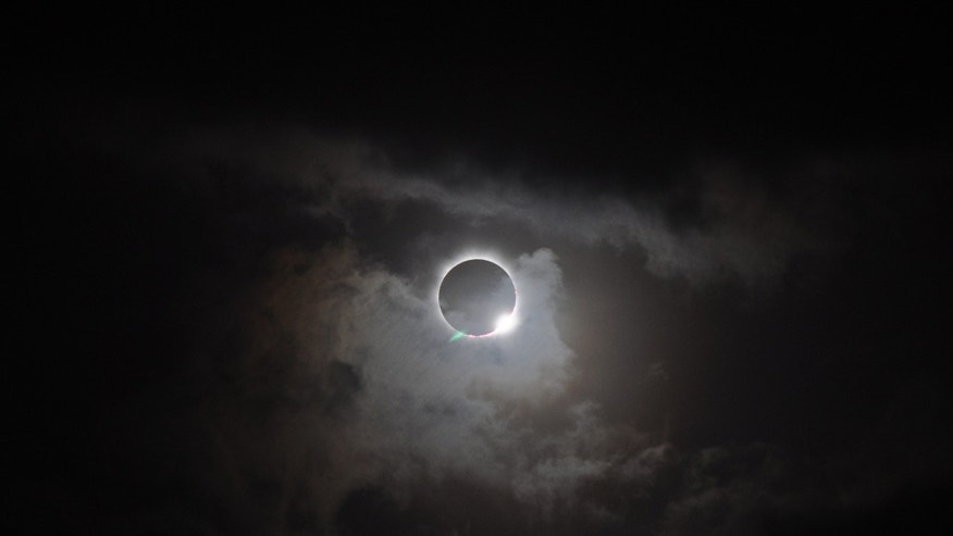 During total solar eclipses — such as this one seen from the northern tip of Australia on Nov. 13, 2012 — the light halo of the sun's atmosphere, called the corona, can be seen. Not only are such eclipses beautiful, they also provide a unique opportunity for scientists to study the corona. (NASA/Romeo Durscher)