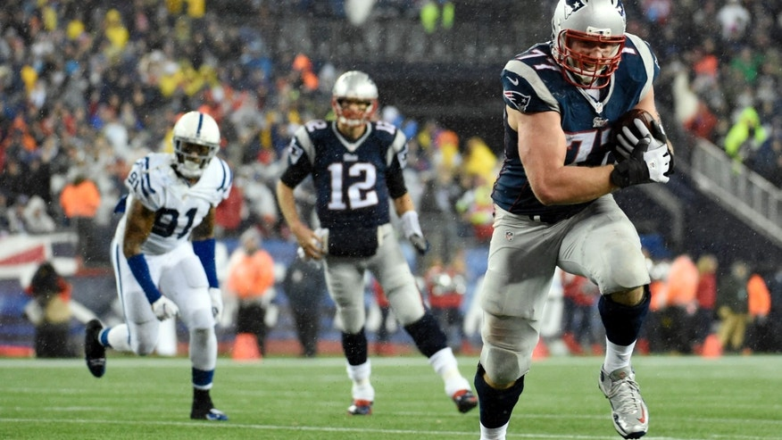 File photo - Jan 18, 2015; Foxborough, MA, USA; New England Patriots tackle Nate Solder (77) catches a pass from quarterback Tom Brady (12) and runs for a touchdown against the Indianapolis Colts in the third quarter in the AFC Championship Game at Gillette Stadium. (Robert Deutsch-USA TODAY Sport)