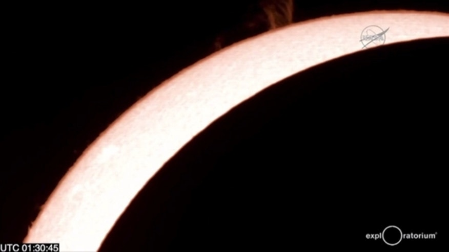Great prominences on the sun are visible in this fiery telescope view of the total solar eclipse of March 8/9, 2016 as seen in a NASA webcast from Woleai Island in Micronesia arranged in partnership with the E