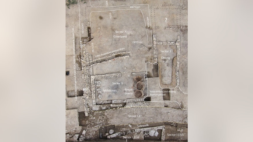 An aerial view of the excavated tavern. Note the kitchen, which held the bread ovens and millstones, and the dining hall, which has a bench around three of its walls.