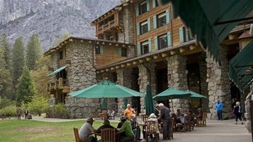 In this Oct. 24, 2015 file photo, people dine outside the Ahwahnee hotel in Yosemite National Park, Calif. (AP Photo/Ben Margot, File)