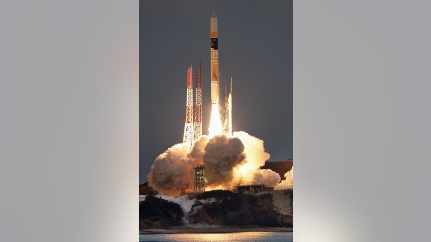 "In this Feb. 17, 2016 photo, an H-2A rocket carrying an X-ray astronomy satellite called ""Hitomi"", is launched from the Tanegashima Space Center in Kagoshima Prefecture, southern Japan. (Kyodo News via AP)"