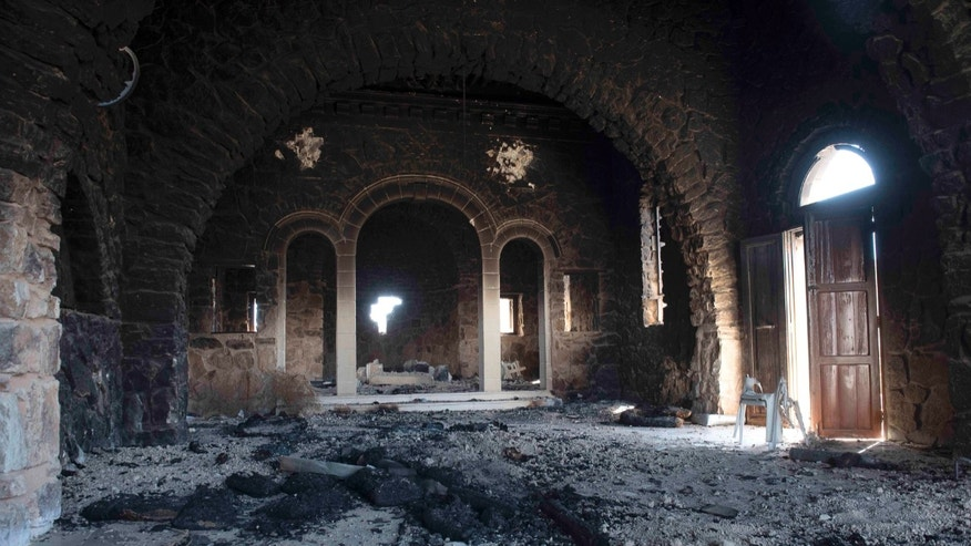 Mar Elian monastery appears ravaged after heavy fighting between Syrian Army and the Islamic State group in Qaryatain, Syria, Monday, April 4, 2016. (AP Photo/Natalia Sancha)