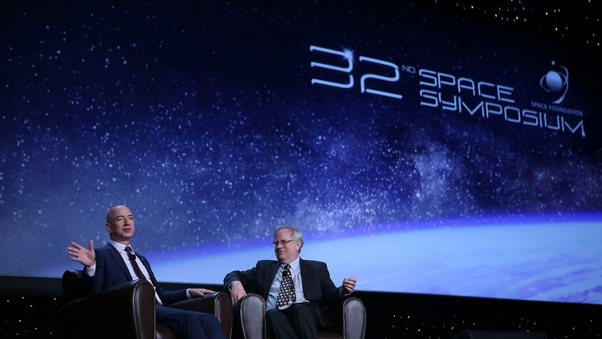 Jeff Bezos, CEO of the private spaceflight company Blue Origin, talking with science writer Alan Boyle at the National Space Symposium on April 12, 2016.