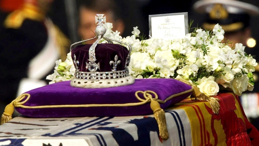 "In this April 5, 2002, file photo, the Koh-i-Noor, or ""mountain of light,"" diamond, set in the Maltese Cross at the front of the crown made for Britain's late Queen Mother Elizabeth, is seen on her coffin."