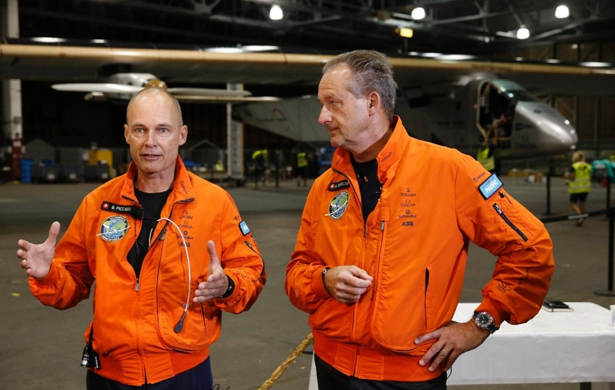 Solar Impulse 2 pilots Bertrand Piccard, left, and Andre Borschberg speak to the media in front of the solar plane from the Kalaeloa Airport, Thursday, April 21, 2016, in Kapolei, Hawaii. The Solar Impulse team landed in the islands in July after a record-breaking flight from Japan. (AP Photo/Marco Garcia)