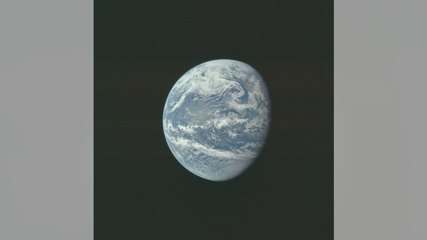 The earth is pictured as photographed from 10,000 nautical miles away during the Apollo 11 mission in this July 16, 1969 NASA handout photo. (REUTERS/NASA/Handout)