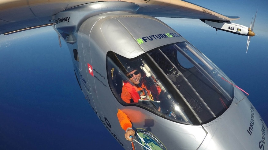 This April 9, 2016 photo provided by Bertrand Piccard via Global Newsroom shows Piccard taking a selfie on board Solar Impulse 2 during a test flight over the Pacific Ocean.