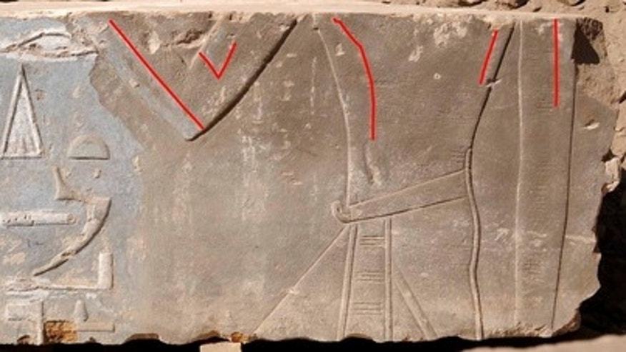 A stone block found on Egypt's Elephantine Island shows Queen Hatshepsut as a female (highlighted by red lines). Later images of the pharaoh portrayed her as a male king.