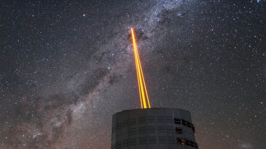 The Four Laser Guide Star Facility for the adaptive optics system on the European Southern Observatory's Very Large Telescope in Chile is activated in this stunning first-light image taken on April 26, 20