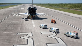 "The full-size mock orbiter ""Inspiration"" was rolled down the runway at the Kennedy Space Center's Shuttle Landing Facility in Florida on April 27, 2016."