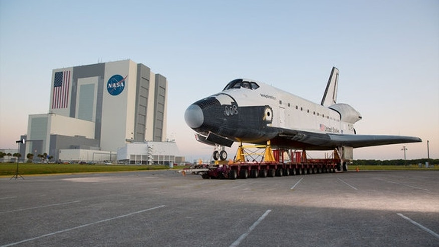 "The mock orbiter ""Inspiration"" was rolled past the Vehicle Assembly Building (VAB) on its way to the Shuttle Landing Facility at NASA's Kennedy Space Center in Florida on April 27, 2016."