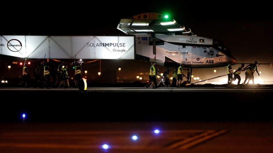 May 2, 2016: Grounds crew pull pilot Andre Borschberg and the Swiss-made Solar Impulse 2 plane to the hanger after landing in Goodyear, Ariz.