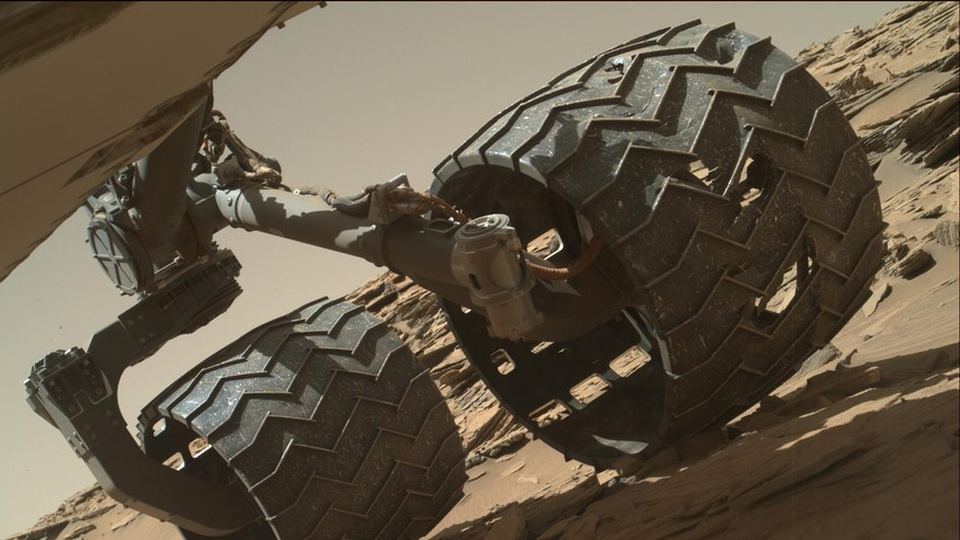 The team operating NASA's Curiosity Mars rover uses the MAHLI camera on the rover's arm to check the condition of the wheels at routine intervals.