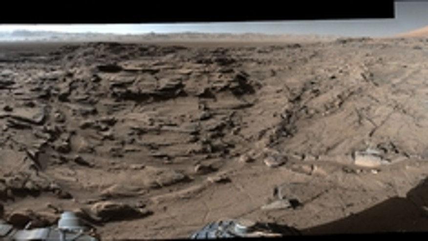 "This 360-degree panorama from the Mastcam on NASA's Curiosity Mars rover shows the rugged surface of ""Naukluft Plateau"" plus upper Mount Sharp at right and part of the rim of Gale Crater."