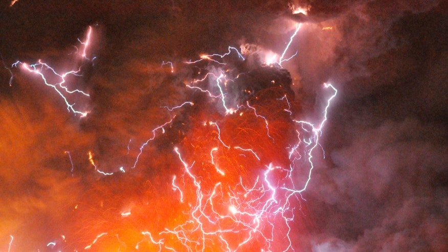 File photo - Volcanic lightning or a dirty thunderstorm is seen above Shinmoedake peak as it erupts, between Miyazaki and Kagoshima prefectures, in this photo taken from Kirishima city and released by Minami-Nippon Shimbun Jan. 28, 2011. (REUTERS/Minami-Nippon Shimbun/Handout)