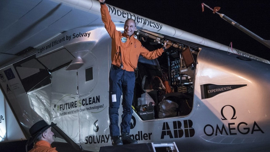 """In this photo provided by Solar Impulse, Bertrand Piccard acknowledges the crowd prior to the takeoff of """"Solar Impulse 2,"""" in Goodyear, Ariz., Thursday, May 12, 2016. The solar-powered airplane that landed in Arizona last week is headed to Oklahoma on the latest leg of its around-the-world journey. (Jean Revillard/Solar Impulse via AP)"""