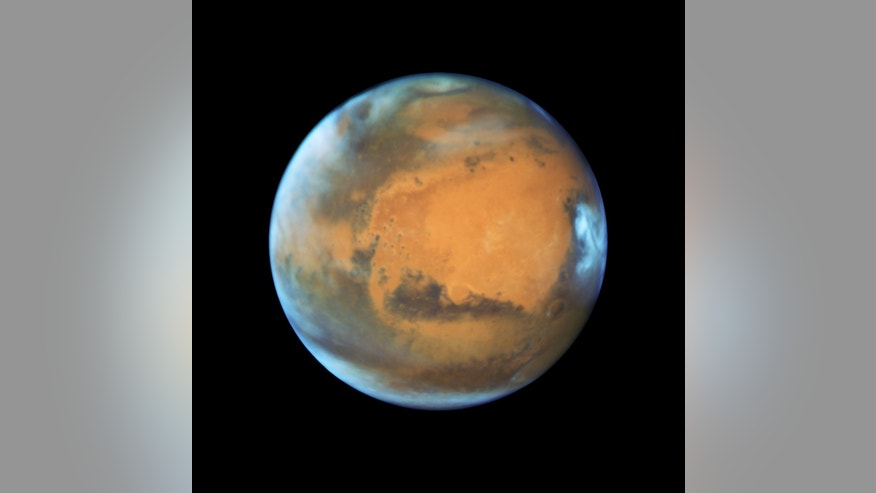 Mars is shown May 12, 2016 in this NASA Hubble Space Telescope view taken when the planet was 50 million miles from Earth. (NASA/Handout via Reuters)