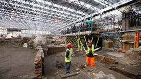 Archaeologists work on the exposed remains as the site of Shakespeare's Curtain Theatre is excavated in Shoreditch in London, Tuesday, May 17, 2016.  Archaeologists are excavating the remains of the Curtain, a 16th-century theater where some of the Bard's play's were staged, before another gleaming tower joins the city's crowded skyline.  (AP Photo/Kirsty Wigglesworth)